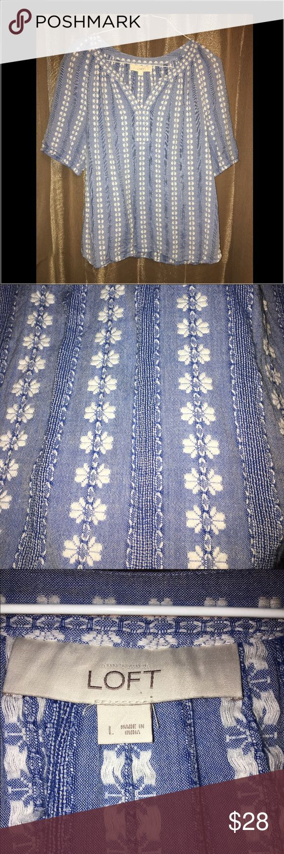 Light jeans and white top size L BEAUTIFUL blue and white printed top from LOFT. ( I took a closer picture of the pattern) Women size L, in great condition. Goes great with fall and winter colors. Love this, only getting rid of it because of weight loss. LOFT Tops Blouses