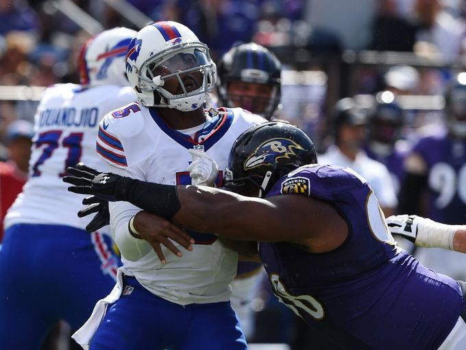 Buffalo Bills quarterback Tyrod Taylor (5) is hit by Baltimore Ravens nose tackle Brandon Williams (98) Tommy Gilligan.  USA Today Sports
