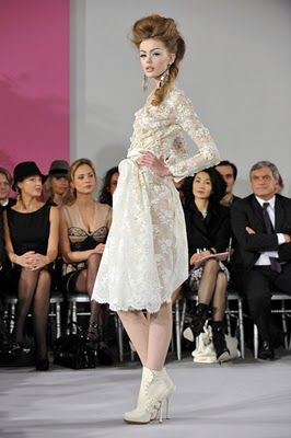 7. Contemporary- Christian Dior SPring 2010 hair inspired by that of the bustle period similar to the waterfall hairstyle