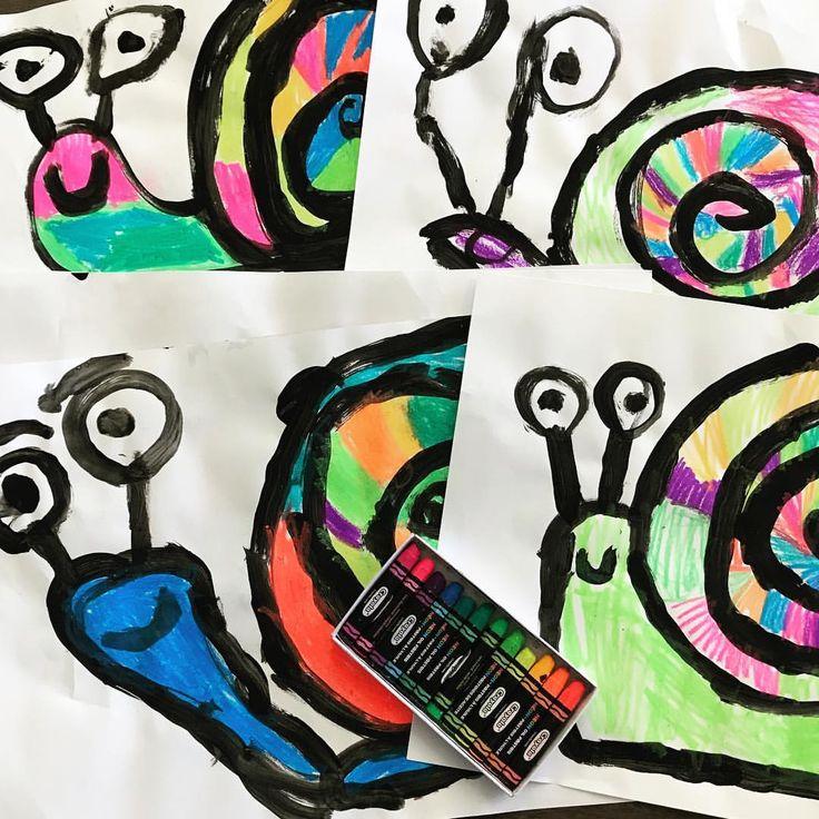 Kindergarten snails using neon oil pastels ️🧡💛💚💙💜🐌.