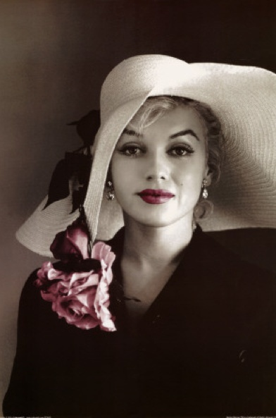 Marilyn Monroe in Floppy Hat with Flower Pin. Looks to be a hand tinted black and white photo.   Marilyn Monroe quote on Love  Marilyn Monroe Quotes  About Love  A wise girl kisses but doesnt love, listens but doesnt believe, and leaves before she is left.  - Marilyn Monroe  Fear of commitment is a common theme for many men. Rare is the woman who loves them and leaves them. But in order to avoid the hurt of heartbreak, Marilyn, like many others leave a relatio