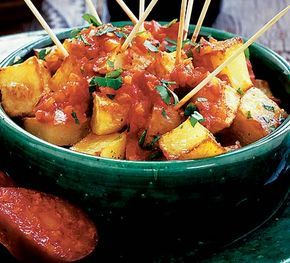 A classic tapas dish - cubes of potato in a spicy, tomato sauce