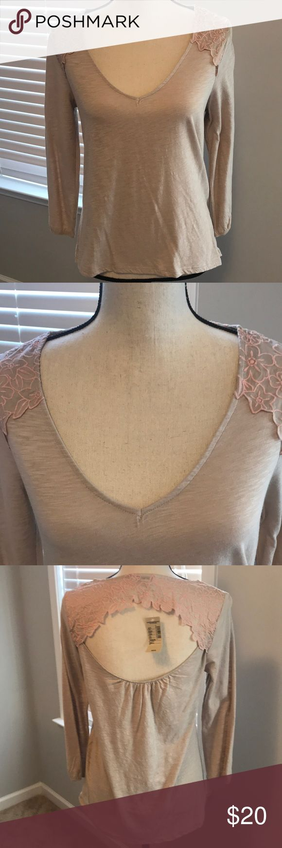 NWT AW cut out back 3/4 shirt 3/4 tan shirt with light pink flowers on shoulders and around back cut out of shirt. Never been worn! Very cute American Eagle Outfitters Tops