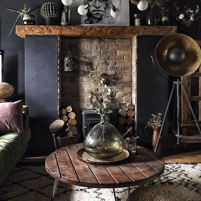 dark and moody walls with a brick inset woodstove make ...