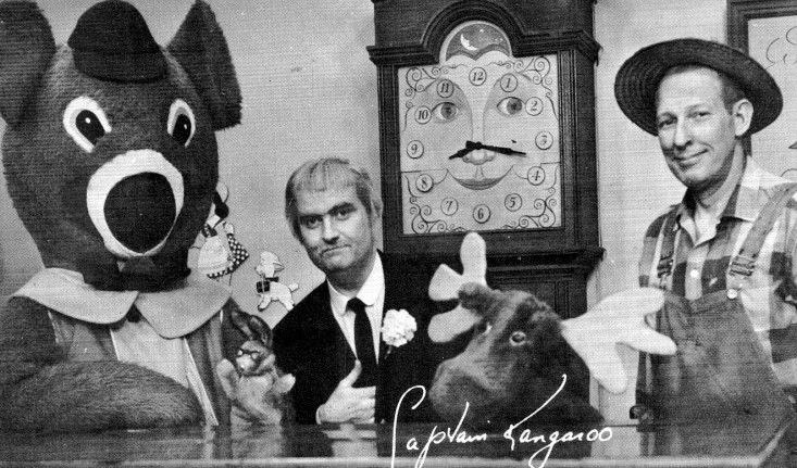 Captain Kangaroo, Mr. Green Jeans, Dancing Bear, Mr. Moose Bunny Rabbit standing in front of Grandfather Clock ; )