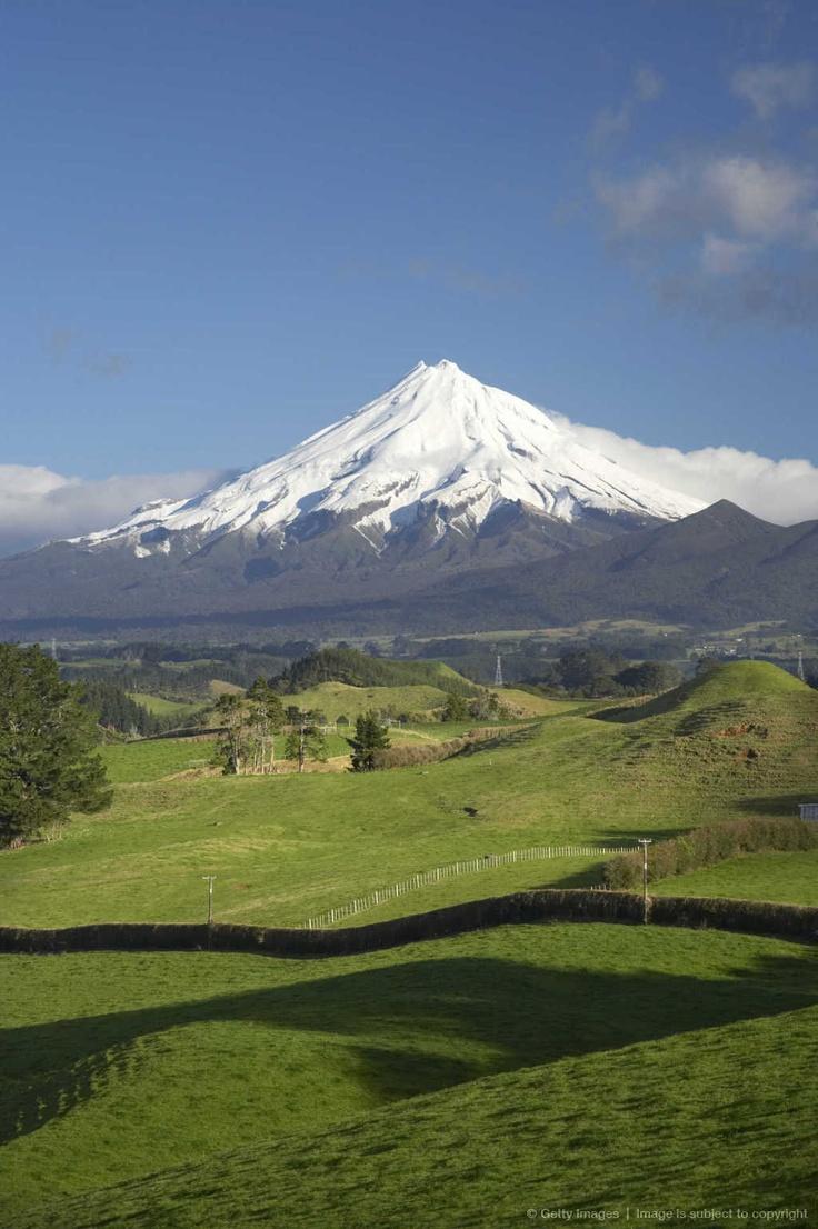 Farmland and Mount Taranaki, near Inglewood, Taranaki, North Island, New Zealand