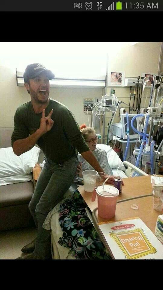 Luke Bryan took time to visit the WVU children's hospital before his show. He made this girl's day!!