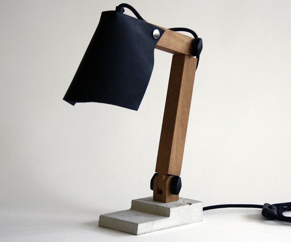 This lamp is named Big Foot. It's foot is made from concrete, the shade of leather. It's delivered with both a brown and black shade so ypu can change te colour!