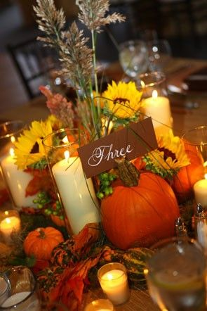 pumpkin and sunflower tablescape | fall in love with more of this seasonal #wedding decor here: http://www.mywedding.com/articles/5-popular-fall-wedding-themes/