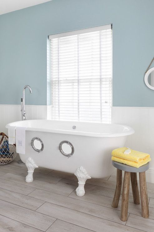 Fun Nautical Themed Kidu0027s Bathroom Centers On A White Claw Foot Tub With  Porthole Windows Paired