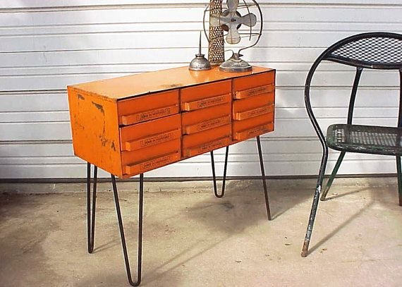 Old tractor-shop toolbox on midcentury hairpin legs.  Love it.