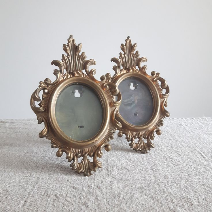 A pair of ornate gold plastic oval picture frames // Hollywood regency style, bamboo-look easels, gilt frames by BlueChickenVintage on Etsy