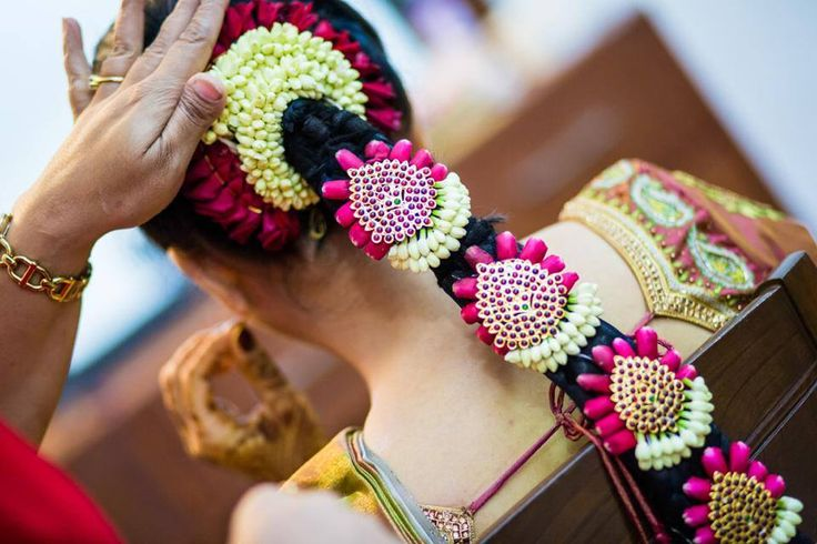 Traditional Southern Indian bride's bridal braid hair. Hairstyle by Swank Studio. Find us at https://www.facebook.com/SwankStudioBangalore