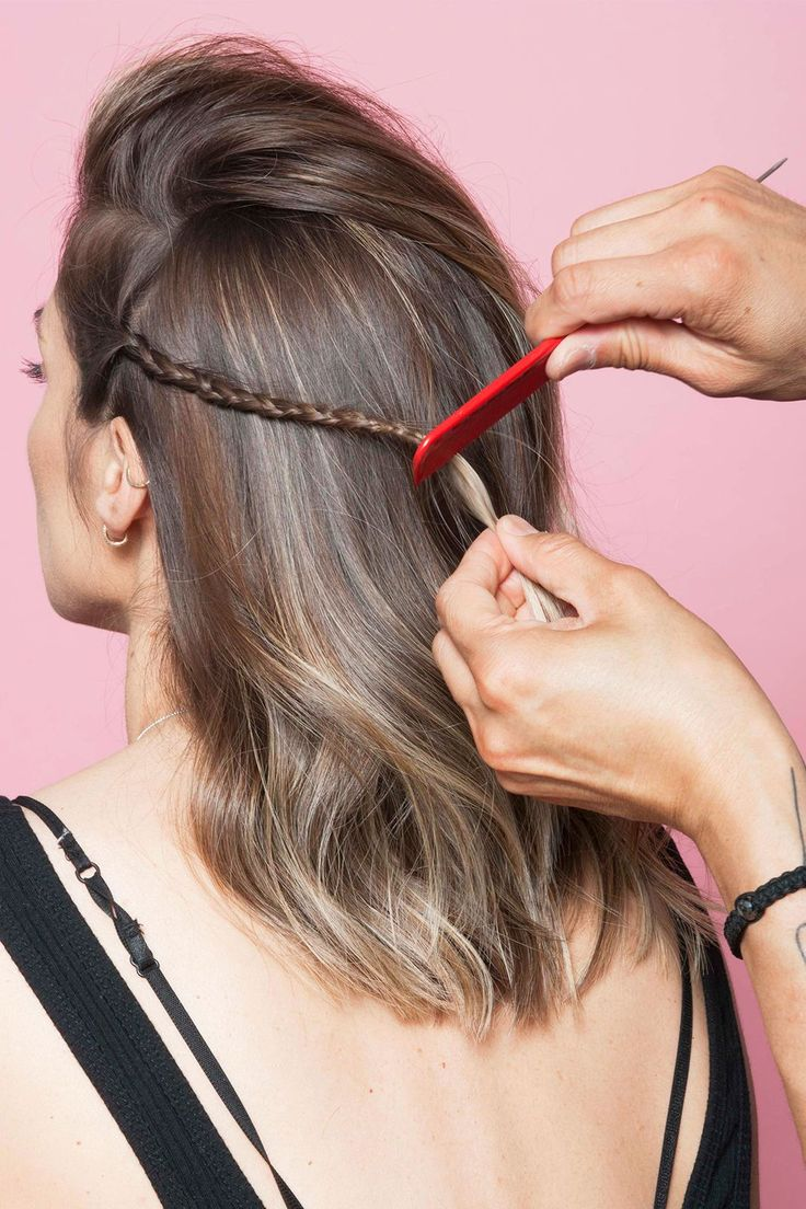 How To Style L.A.'s Most Popular Haircut 3 Ways In 3 Days #refinery29 http://www.refinery29.com/anh-co-tran-layered-long-bob#slide-11 Use a fine-tooth comb to tease the ends of your braid. This will hold the plait in place without an elastic.