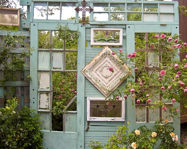 old doors and windows for privacy screen in the garden