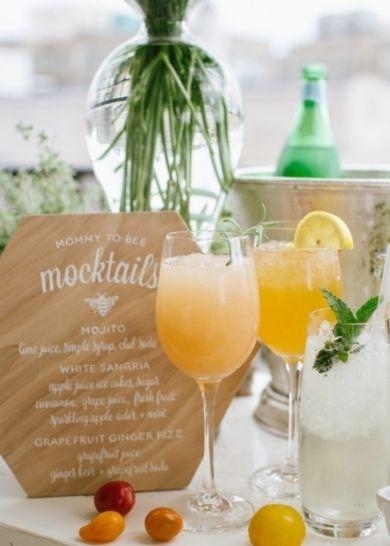 mocktails Mojito: lime juice, simple syrup, club soda. White Sangria: apple juice ice cubes, sugar, cinnamon, grape juice, fresh fruit, sparkling apple cider and mint. Grapefruit Ginger Fizz: grapefruit juice, ginger beer, grapefruit soda