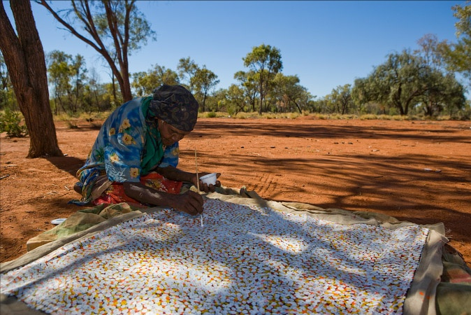 The ever lovely Polly Ngale painting 'Bush Plum Dreaming' in the Utopia region of Central Australia