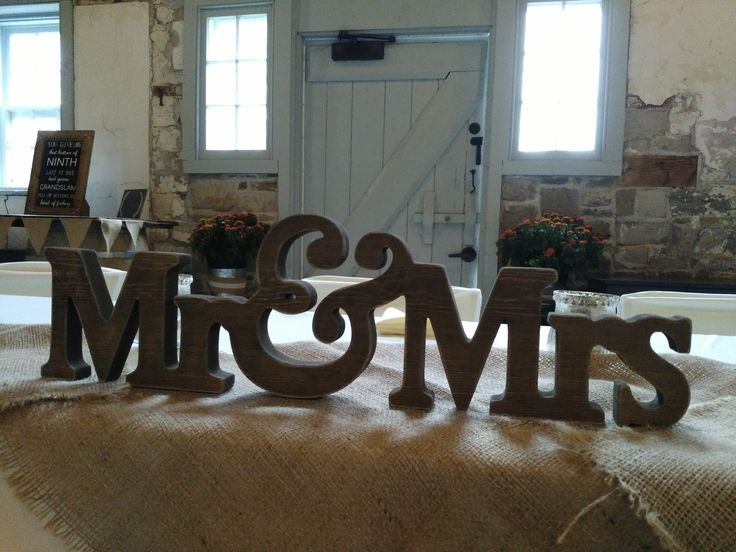 Woodsy accents take center stage - even at the head table! - at this idyllic October 2017 wedding set up in Ruthven Park's historic Coach House.
