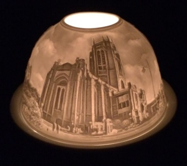 This stunning tea light candle holder is exclusive to Liverpool Cathedral! It has 3 beautiful images of Liverpool Cathedral etched into a ceramic dome. Included in the presentation box, there is also a ceramic plate to place your tea light!