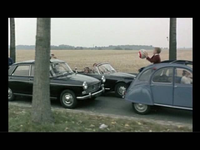 Godard captures the essence of the automobile. (With commentary)