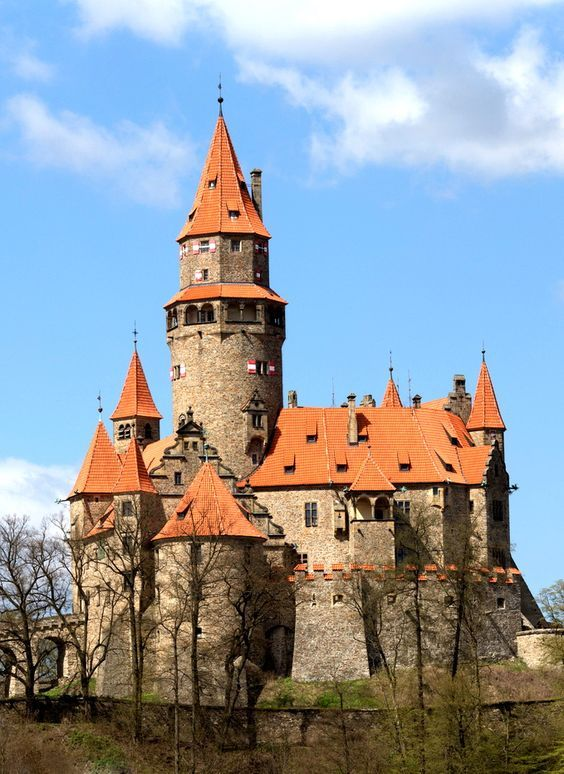 Bouzov Castle is an early 14th-century fortress first mentioned in 1317. It was built on a hill between the village of Hvozdek & the town of Bouzov in Moravia, Czech Republic. Bouzov was established at the turn of the 14th century with the purpose to watch over the trade route from Olomouc to Loštice.: