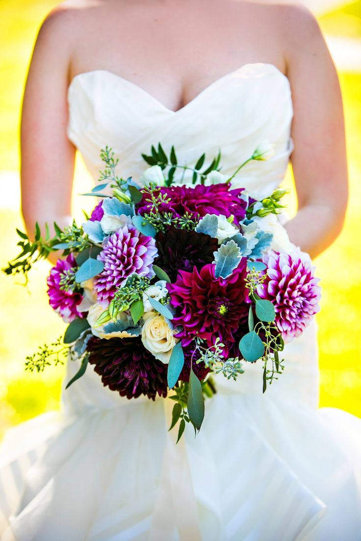AMAZING for a fuchsia or purple wedding. Love the dahlias in this bouquet! | Photograph by Kurstin Roe Photography