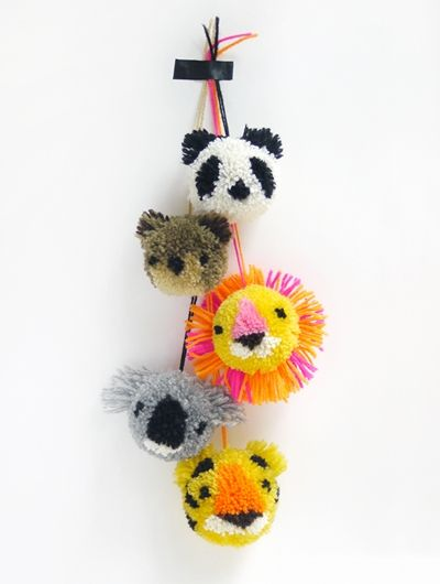 DIY: A bunch of zoo animals Is there anything more adorable than a bunch of animal pom poms hanging together? I think not. The diy tutorial on how to make  your very own animal pom poms is available here at Mr Printables blog.