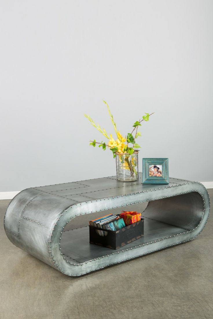 Aviator Coffee Table $1200 retail 57W18H24D polished alumnum with exposed steel screws in patchwork style, inspired by 20th centure aircraft a la howard hughes