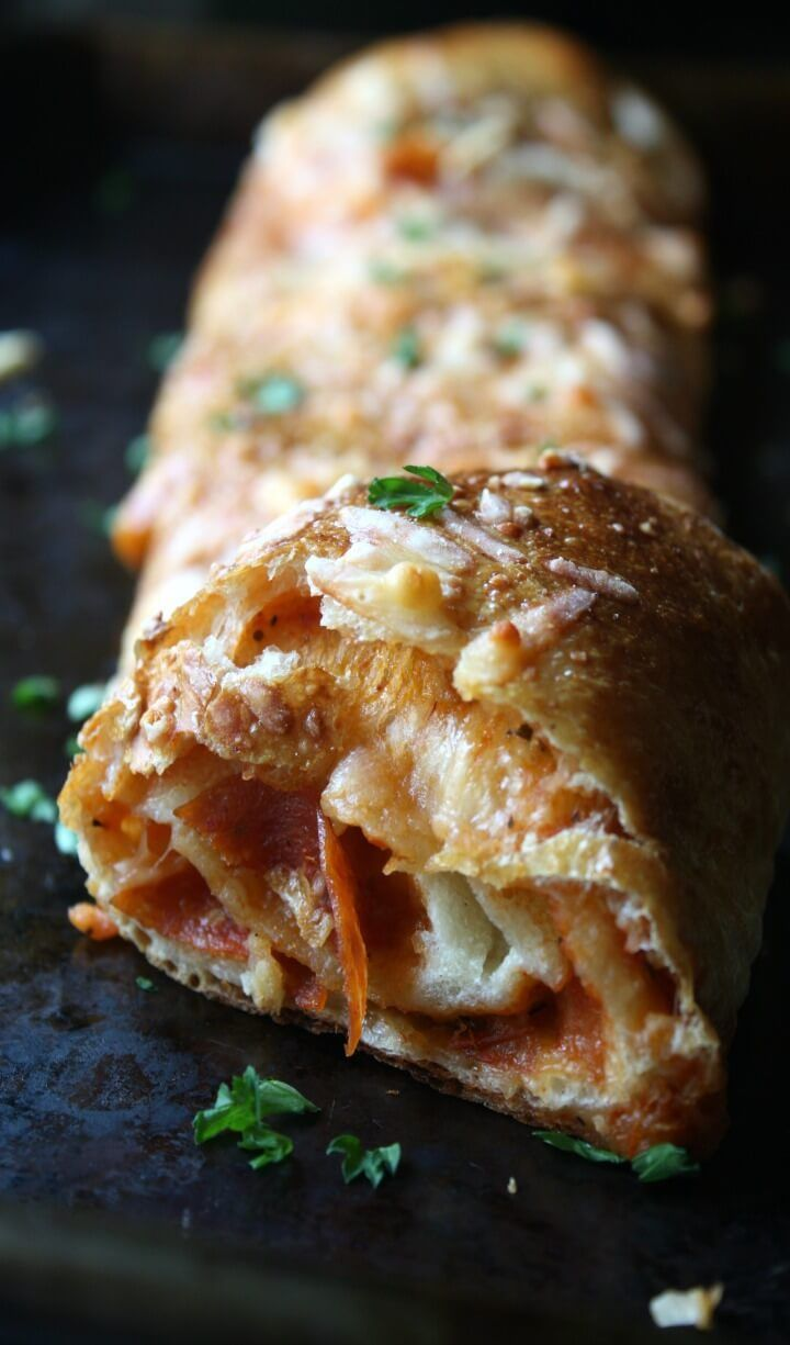 This Easy Pepperoni Stromboli uses premade refrigerated pizza crust and is ready in less than 30 minutes. A delicious alternative to pizza night.