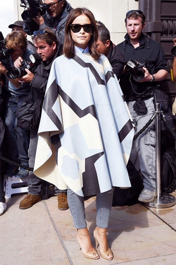 Miroslava Duma makes a style statement in a geometric leather cape. // #CoutureWeek #Fashion