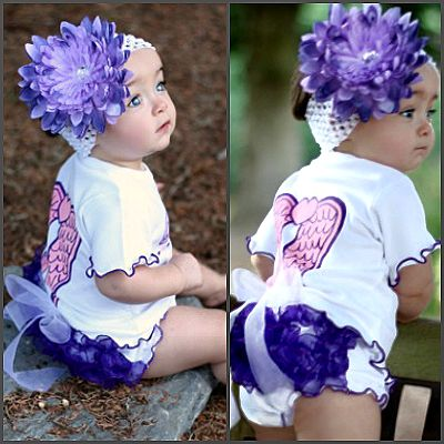 'Blessed' Bailey Ruffled Baby Bloomers. Simply Adorable! This white soft and stretchy knit bloomer features 3 rows of stunning purple organza ruffles. Perfect for photos with it's fun and frilly look, it's sure to put a smile on mum and dad's face now and in years to come!
