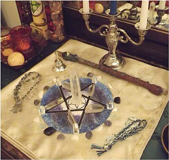 This is a great example of an altar that is set up for ritual. Here we see the objects hold the most meaning, and even the placements matter as well.