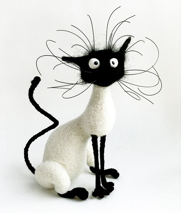 Handmade toy cat Solange from Hallmarks of Felinity by Brooke McEldowney. Materials: pure wool sheep, polymer clay, jewelry cable.