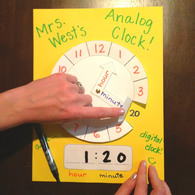 Analog clock with dry erase digital clock. Flip up numbers to reveal minutes. Use clear packaging tape for dry erase abilities