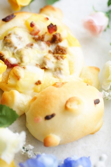 Pig pizza. This site has really cute bread ideas, too bad I cant understand :(  but the pics are great to look at.