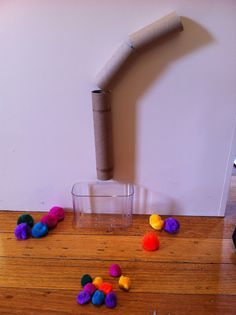 I love a simple idea that is easy to set up, fun for children and education. Let me tell you more… It's Educational It teaches children (especially babies or young toddlers) about cause and effect. So to explain, if I drop a pompom into the top of this tube it suddenly appears …