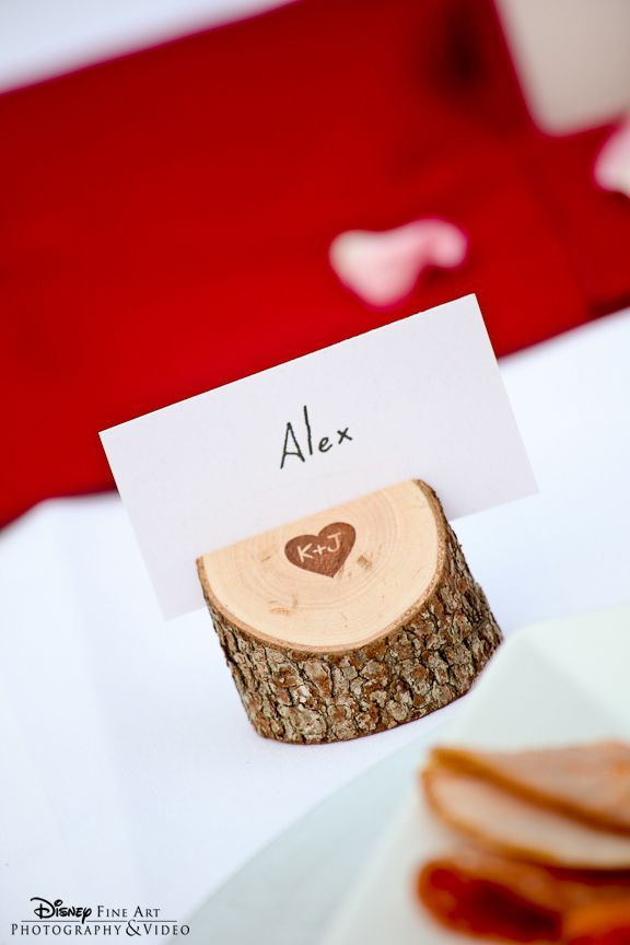 Tree trunk place cards enscribed with the