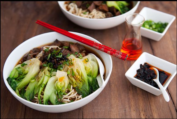 """Taiwanese beef noodle soup: takes 2 days to make! 2.5 lbs. beef (marrow)bones, 2.5 lbs. beef shank (bone in), 2 star anise, 1 tsp fennel seeds, 2 g angelica root, 2 g dried orange peel, 1 tbs Sichuan peppercorns, 6 g cassia buds, 1 tbs cinnamon bark, 6 g cinnamon sticks, 4 tbs oil, 6 green onions, 12-14 garlic cloves, 2"""" ginger, 4 Thai bird chiles, 1 oz rock sugar or 2 tbs dark brown sugar, 3/4 cup hot bean paste, 1 cup soy sauce, 1/2 cup spicy fermented bean curd, 1/4 cup tom"""