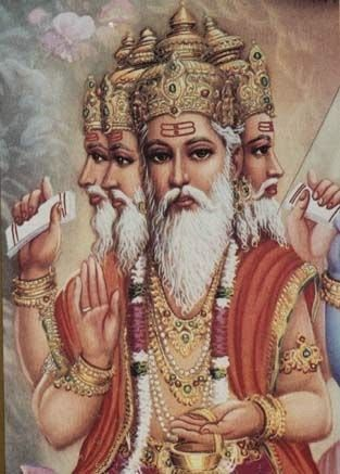 Brahma - The Creator ~ HiNDU GOD Brahma is commonly represented as having four heads, four arms, and red skins. Unlike all the other Hindu gods, Brahma carries no weapon in his hands.  He holds a water-pot, a spoon, a book of prayers or the Vedas, a rosary and sometimes a lotus.