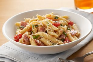 Pizza Pasta Salad recipe...why stop at the recipe..onions, peppers, olives, pepperoni yup I would definitely jazz it up even more.