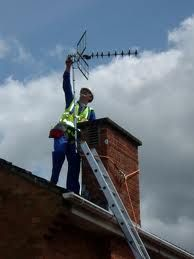 TV Engineer Installing Sky Dish