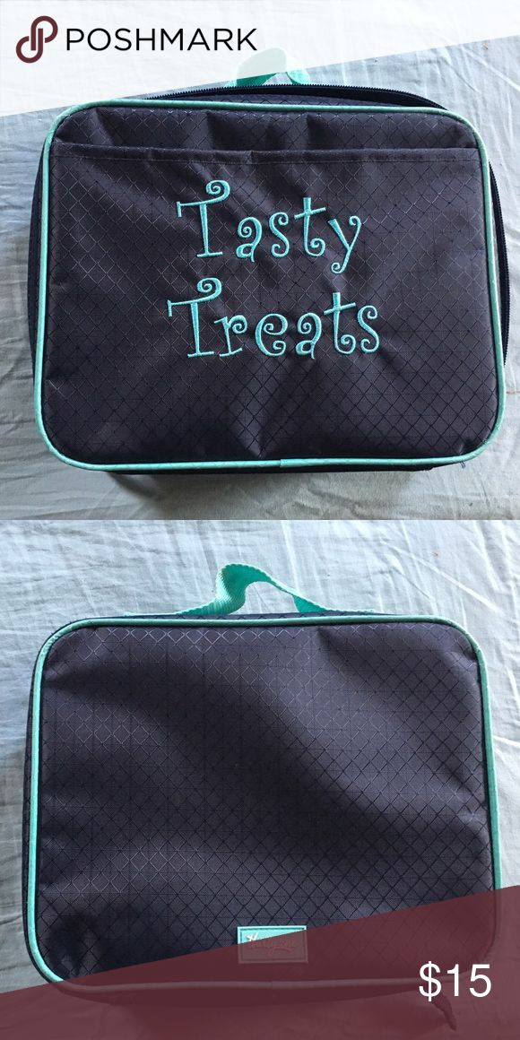 "Thirty One Insulated Lunch Bag, Navy Thirty One Insulated Lunch Bag with ""Tasty Treats"" embroidered on the front, zips on three sides. Only used a handful of times. Perfect for you or your little one's lunch! Thirty One Bags Totes"