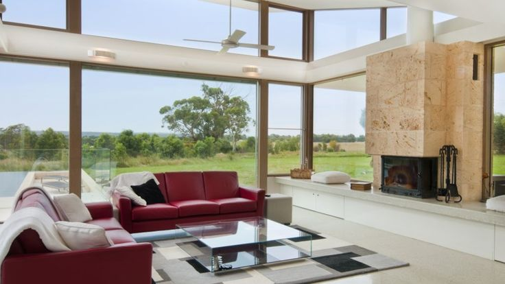 Lounge room with a view. Combined with natural limestone fireplace and polished concrete. Great combination.