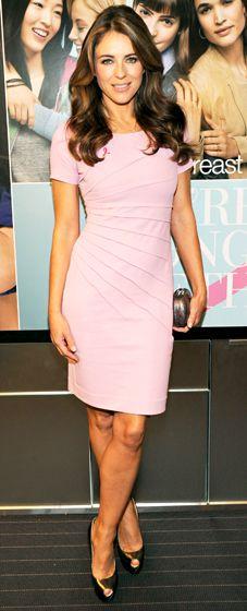 Elizabeth Hurley in a pink bandage dress and gold peeptoe heels