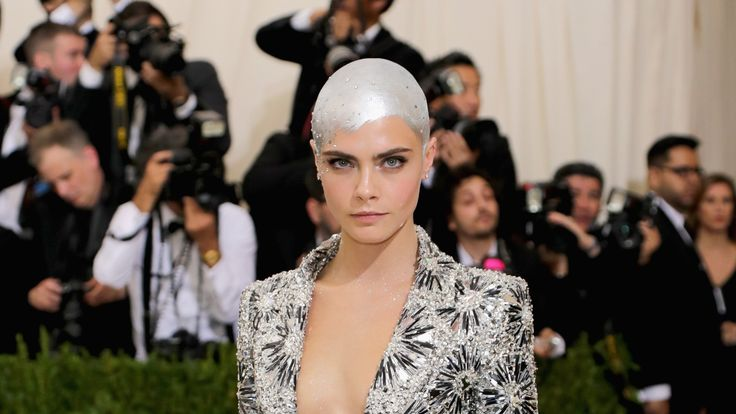 "At the 2017 Met Gala, fashion's most anticipated red carpet, the world's most famous fashion designers, models, and celebrities celebrated the Costume Institue's new exhibition, ""Rei Kawakubo/Comme des Garcons"" by attending the annual fundraiser wearing on-theme, outrageous hair and bold makeup. Mixing smoky eyes in all colors with sleek up dos, these A-listers know how to perfect adventurous beauty. From singers Selena Gomez and Rihanna's playful eyeshadow to L..."