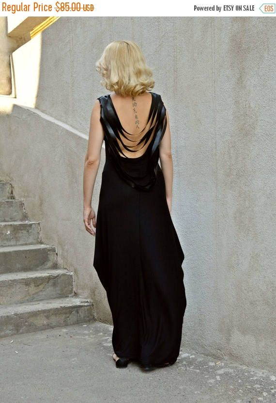 Black backless dress with funky eco leather fringes. Very stylish, comfortable and out-of-the-box maxi dress. The great fabric makes it easy and fun to wear, creating both a playful and an elegant vibe around this unique look. Material: 95% viscose, 5% elastane Care instructions: Hand wash at 30 degrees. The model in the picture is size S.  Can be made in ALL SIZES.  If you have any other specific requirements, do not hesitate to contact me!  I DO NOT CHARGE EXTRA MONEY for custom made…