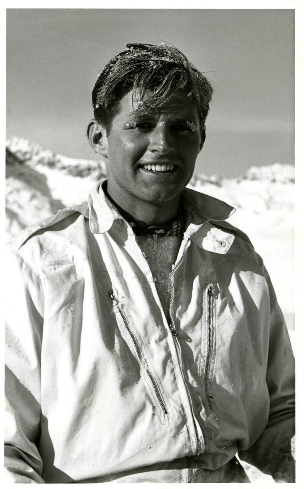 """Joseph P. Kennedy, Jr., outdoors in Saint Moritz, Switzerland, in 1939. The following is handwritten on the verso of the photographic postcard, presumably by John F. Kennedy: """"Joe at Switzerland - 1939."""" A brownish residue covers most of the verso of the photographic postcard. This photograph is currently held in the Kennedy Family Collection and is un-numbered."""