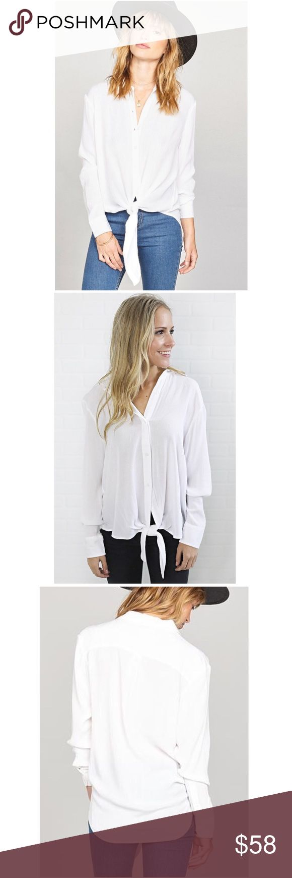 """Perfect White Top Oui oui. The C'est La Vie Woven is a crinkle and pigment dyed top with a front tie and button placket. An Amuse staple with its soft gauze touch and classic button down style, we'll definitely be getting this in every color.   *100% Viscose Gauze Crepe  *Turn garment inside out before hand wash cold  *Hang dry   Measurements for Small:  Bust: 44""""  Front Length: 35 1/2""""  Back Length: 28""""  Sleeve Length from Shoulder: 31"""" Amuse Society Tops"""