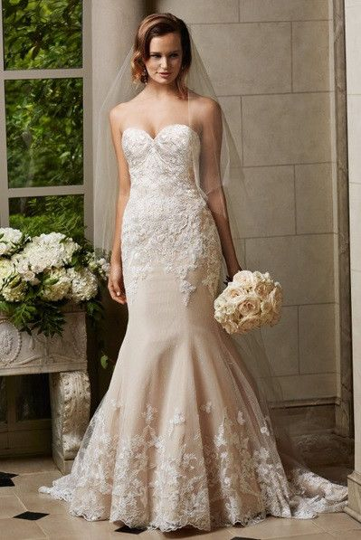 Watters Cosette elegant and romantic, this fit and flare gown in dotted net and tulle features a sweetheart neckline and thoughtfully placed lace motifs. Chapel train. Fabric: Dotted Netting, Tulle, L