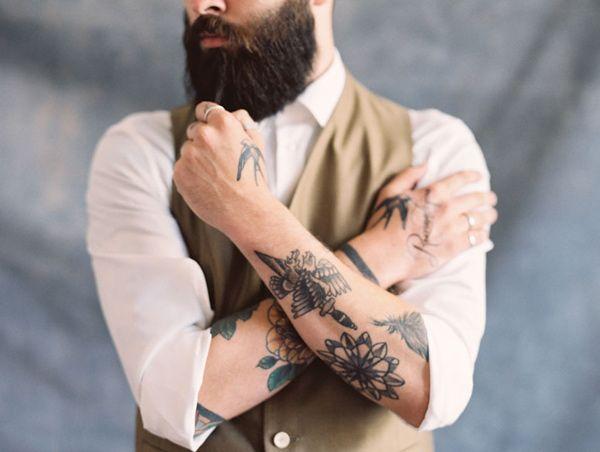 tattooed groom, photo by Laura Gordon Photography http://ruffledblog.com/claire-pettibone-romantique-2015-bridal-collection #grooms #tattoos
